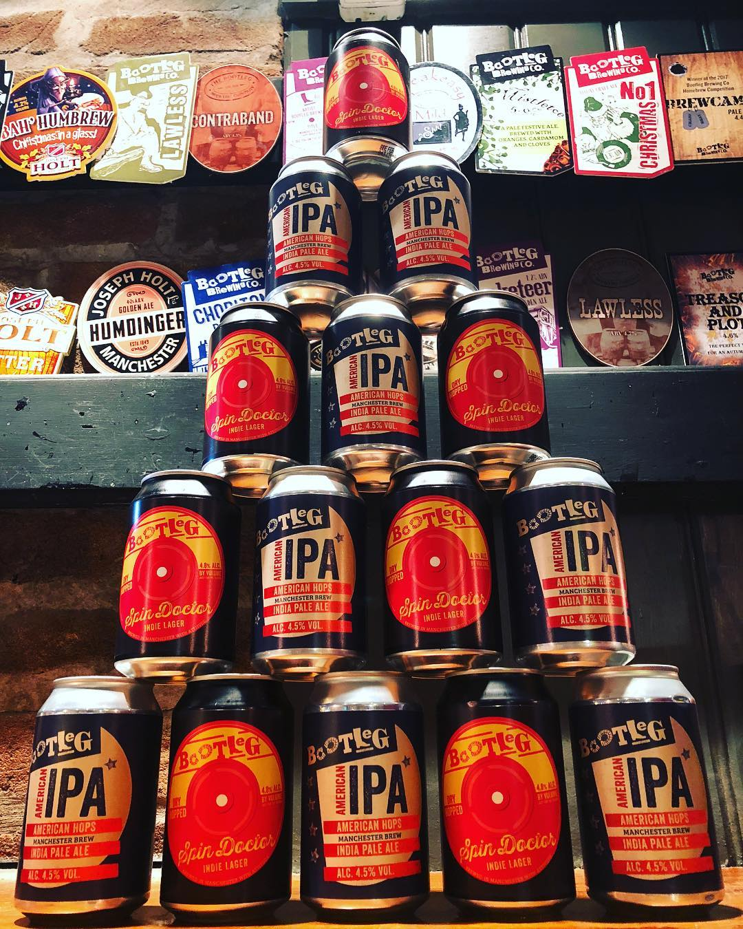 A pyramid of our Spin Doctor and American IPA Beer Cans.
