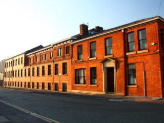 Joseph Holt main brewery red brick building in Manchester